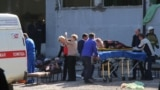 Российские спасатели помогают пострадавшим от взрыва в Керчи