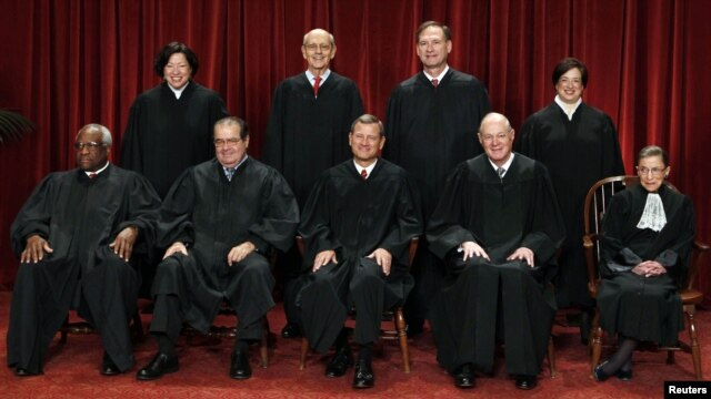 Associate Justice Antonin Scalia (2nd left, front row) sits among the other justices of the U.S. Supreme Court for a group portrait in Washington in October 2010.