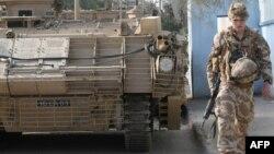 جندي بريطاني يسير أمام مدرعته في شارع بالبصرة