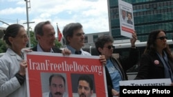Protesters at the United Nations participate in one of the global vigils held for Arash and Kamiar Alaei.