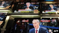 U.K. -- Televisions show former Prime Minister Tony Blair giving evidence to the Iraq War Inquiry in a shop in London, 29Jan2010