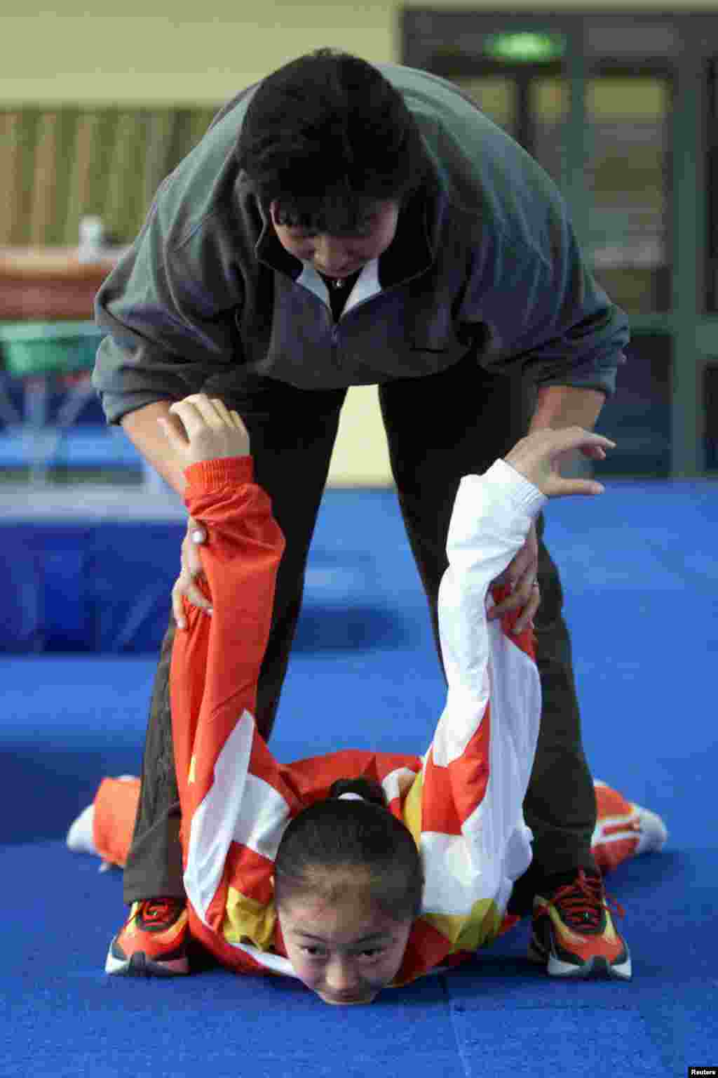 "The 2000 Sydney Olympics saw a record-equaling eight medals for China's gymnastics team, until some questions were raised about Dong Fangxiao. An investigation found she had been just 14 while competing -- two years below the minimum age. A Chinese state-controlled newspaper quoted an expert as saying, ""Coaches -- and not just in China -- have also long falsified ages for girls whose small and supple bodies give them a competitive advantage over larger and older young women."""