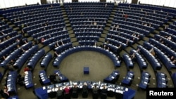 FILE PHOTO: Members of the European Parliament attend a plenary session of the European institution in Strasbourg October 20, 2008. REUTERS/Vincent Kessler/File Photo