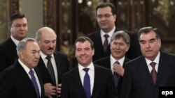 Russian President Dmitry Medvedev (center) is surrounded by presidents from the EEC countries.