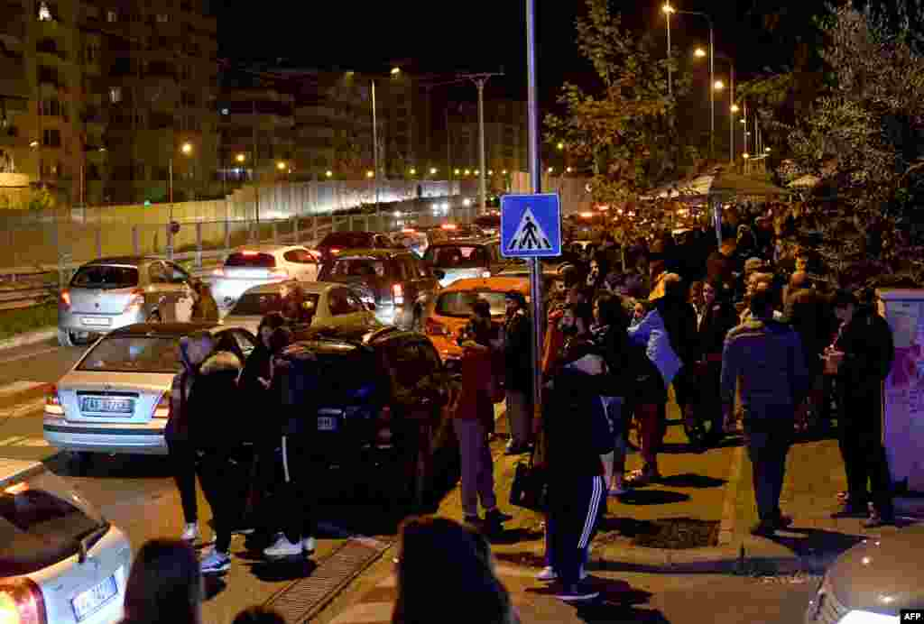 Residents gather outdoors in Tirana, home to nearly 900,000 people, after the first quake hit at around 3:50 a.m. Dozens of aftershocks followed.
