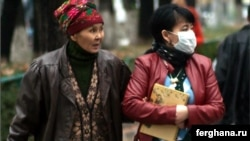 People wear protective masks against swine flu in Bishkek earlier this month.