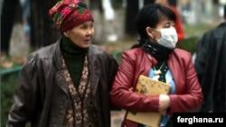 People wear protective masks against swine flu in Bishkek earlier this month.