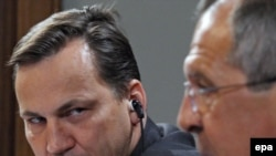 Will Polish Foreign Minister Sikorski (left) be watching for signs of Russian meddling?