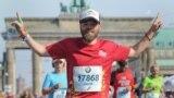 Jared Goldman finishing marathon in Berlin
