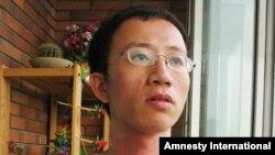 Правозахисник Ху Цзя під домашнім арештом<br />(Архівне фото. Пекін, липень 2006 р.)