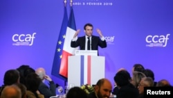 France -- French President Emmanuel Macron speaks during the Coordination Council of Armenian Organisations of France (CCAF) annual dinner in Paris, February 5, 2019.