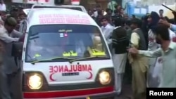 An ambulance rushes to the scene of a bombing at a Shi'ite mosque in Shikarpur, Pakistan, on January 30.