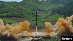 The intercontinental ballistic missile Hwasong-14 is shown during its test-launch in this undated photo released by North Korea's Korean Central News Agency on July 4 .