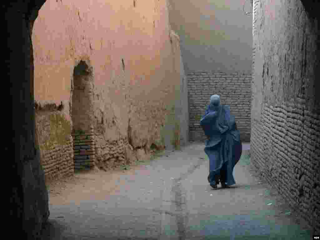 A woman walks on a street of Herat, Afghanistan. Photo by Jalil Rezayee for epa