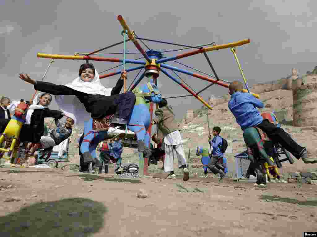 Afghan children play on a makeshift carousel on a street in Kabul on March 29. Photo by Omar Sobhani for Reuters