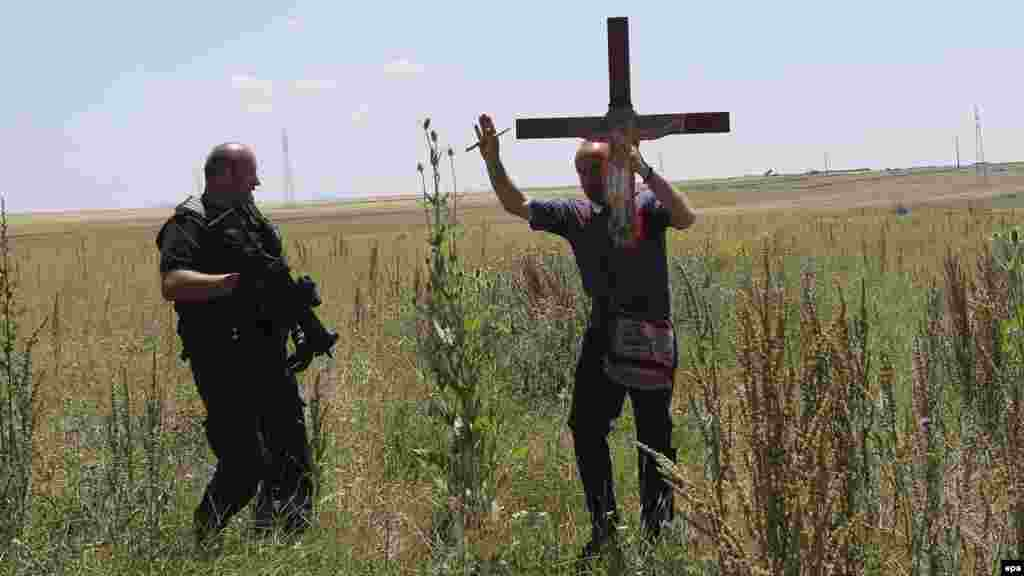 A police officer prevents an ethnic Serb from using a secondary road on his way to celebrate St. Vitus Day in Gazimestan.
