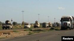 مركبات عسكرية تحمل قوات عراقية تتحرك بإتجاه الحويجة قرب كركوك.