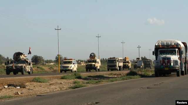 Iraqi troops travel in military vehicles towards Hawija, near Kirkuk on April 23