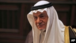 Saudi Prince Turki al-Faisal talks to the Associated Press in Abu Dhabi, United Arab Emirates, Saturday Nov. 24, 2018. A prominent Saudi royal says whether or not heads of state gathered in Argentina next week for the Group of 20 summit warmly engage with