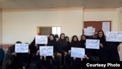 Iranian teachers protest in Alborz province, March 4. They hold signs expressing dissatisfaction with hyperinflation and low wages.