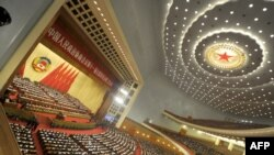 Delegates attend the opening session of the Chinese People's Political Consultative Conference (CPPCC) in the Great Hall of the People in Beijing on March 3.
