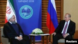 Hassan Rouhani və Vladimir Putin