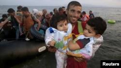 Сирійські біженці, які досягнули грецького острова Кос