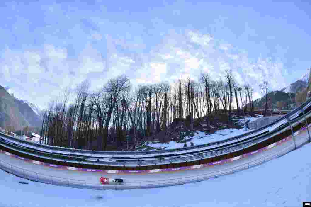 Switzerland's two-woman bobsleigh steered by Fabienne Meyer takes a practice run during a training session at the Sanki Sliding Center in Rosa Khutor. (AFP/ Lionel Bonaventure)