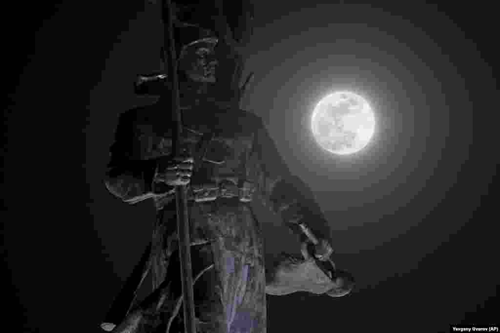 A full moon shines over a monument dedicated to Red Army heroes in Vladivostok, Russia. (AP/Yevgeny Uvarov)