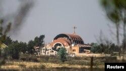 Սիրիա -- Ասորական եկեղեցի, որը, ակտիվիստների պնդմամբ, վնասվել է «Իսլամական պետության» տեղադրած ռումբի պատճառով, Թել Նուսրի, 21-ը մայիսի, 2015