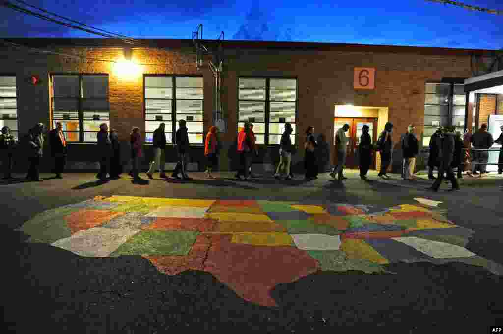 People enter Washington Mill Elementary School to cast their votes in Alexandria, Virginia.