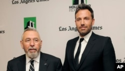 """Ben Affleck, right, a cast member and director of the film """"Argo,"""" poses with former C.I.A. agent Tony Mendez, whom he portrays in the film, backstage at the 16th Annual Hollywood Film Awards Gala on Monday, Oct. 22, 2012, in Beverly Hills, Calif. (Photo"""