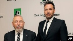 The director and star of Argo, Ben Affleck (right), poses with former CIA agent Tony Mendez in 2012