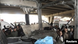A bus is damaged after an explosion in the Maidan district of Damascus on January 6.