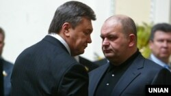 Former Ukrainian government minister Mykola Zlochevskiy (right) was closely associated with ousted President Viktor Yanukovych (left).