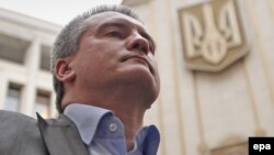 """""""Supply the homes that are entirely dependent on electric power, and supply the other ones using generators under a separate scheme. Do it! We've said this 100 times. (Expletive) No damn thing is working anywhere,"""" Sergei Aksyonov said. (file photo)"""