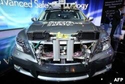Прототип первой самоуправляемой машины представлен в Лас-Вегасе. 8 января 2013 года.