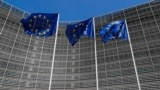 BELGIUM -- European Union flags flutter outside the EU Commission headquarters in Brussels, Belgium June 20, 2018.