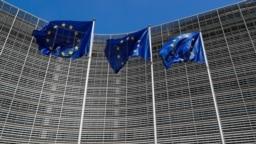 BELGIUM -- European Union flags flutter outside the EU Commission headquarters in Brussels, Belgium June 20, 2018.