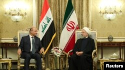 Iran's President Hassan Rouhani meets with Iraq's President Barham Salih in Tehran, Iran, November 17, 2018. Official President website/Handout