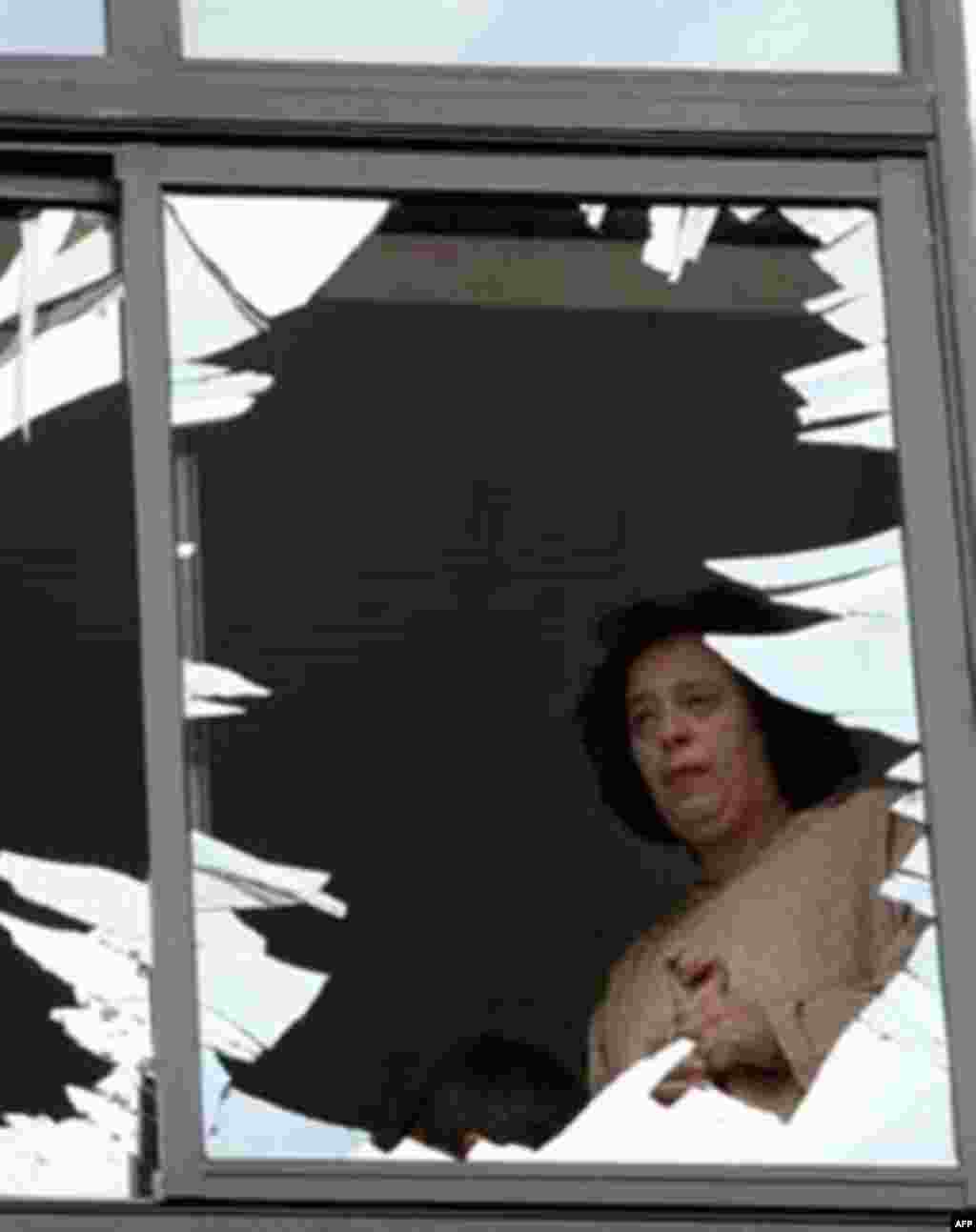 A woman surveys the damage caused by a bomb at a Jewish center in Casablanca, Morocco, on May 17, 2003 (AFP) - At least five bombs exploded simultaneously in Casablanca, Morocco, on May 17, 2003, killing 45 people and injuring scores more. The authorities blame the attacks on Al-Qaeda-affiliated terrorists.