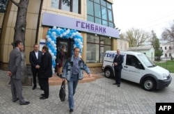 Visitors leave a newly opened branch of Genbank in the Crimean capital Simferopol in April 2014.