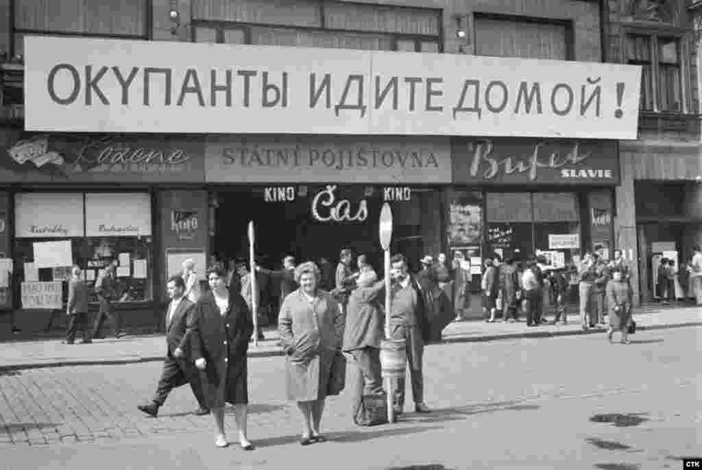 """A Russian-language banner in the city of Plzen, in western Czechoslovakia, reads """"Occupiers Go Home."""""""