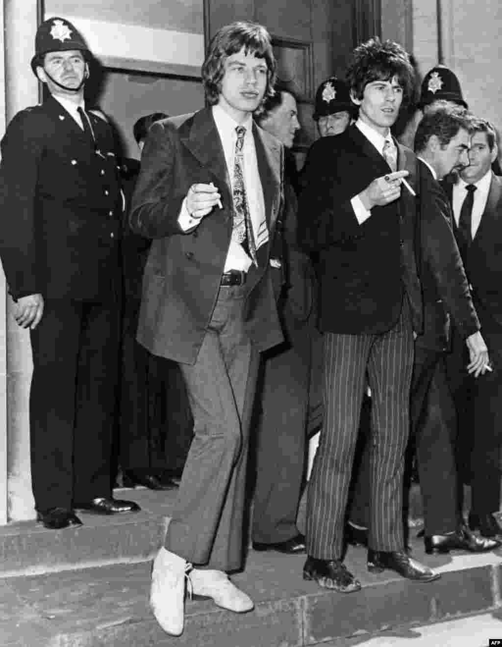 Jagger and Richards leave a court in Chichester, England, after being charged with drugs possession in 1967 following a police raid of Richards' home.