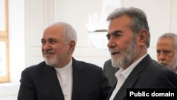 Ziyad al-Nakhalah, the leader of Palestinian Islamic Jihad with Iran's foreign minister Mohammad Javad Zarif. FILE PHOTO