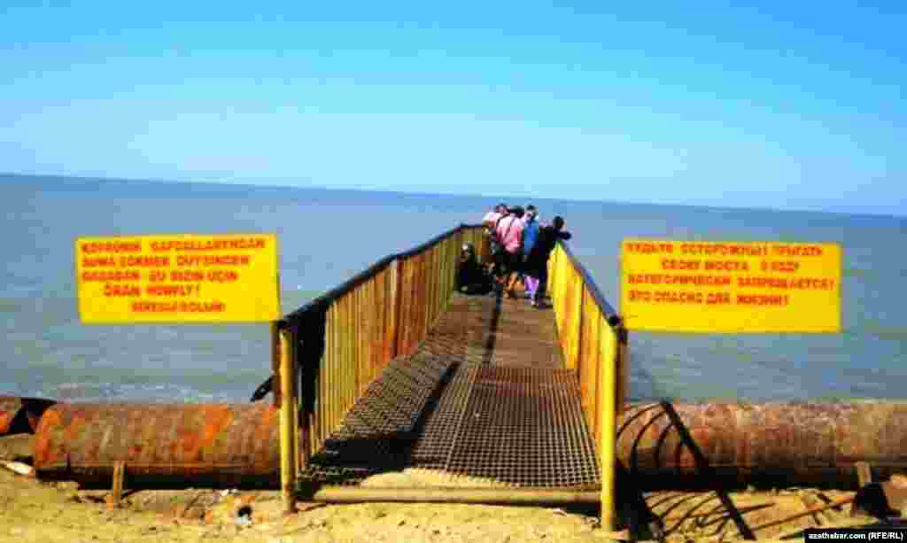 Signs warn about the lethal dangers of diving into this section of the Caspian Sea.