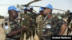 Patrick Nyamvumba (right), commander of the African Union-UN Hybrid Operation in Darfur (UNAMID), arrives in West Darfur to investigate the June 21 ambush on Rwandan peacekeepers that left three dead.