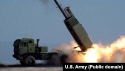 از این سامانه پیشتر در عراق و افغانستان استفاده شده بود. این تصویر موشکانداز و کامیون حامل آن را در سال ۲۰۰۵ میلادی نشان میدهد.