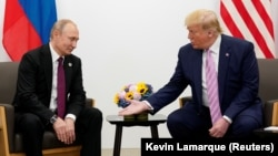 U.S. President Donald Trump gestures during a bilateral meeting with Russian President Vladimir Putin at a Group of 20 leaders summit in Osaka, Japan, last year.