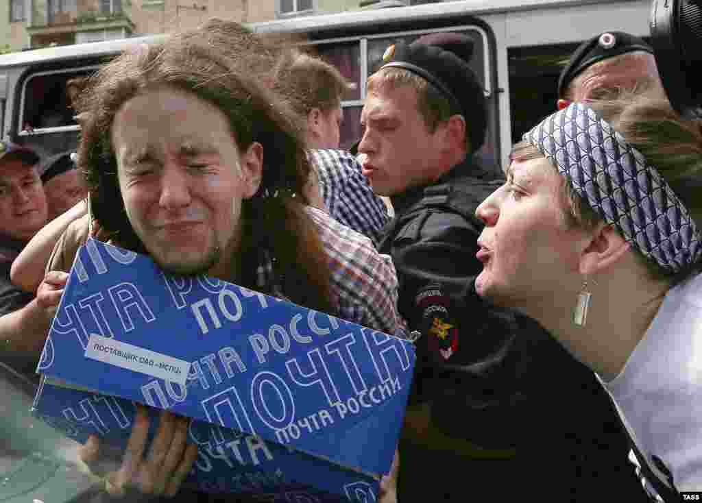 An Orthodox believer spits on a gay-rights activist.